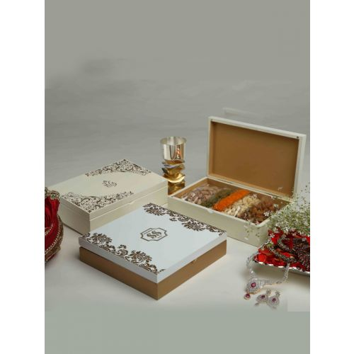Laquered box with gold plated floral design and signature custom made